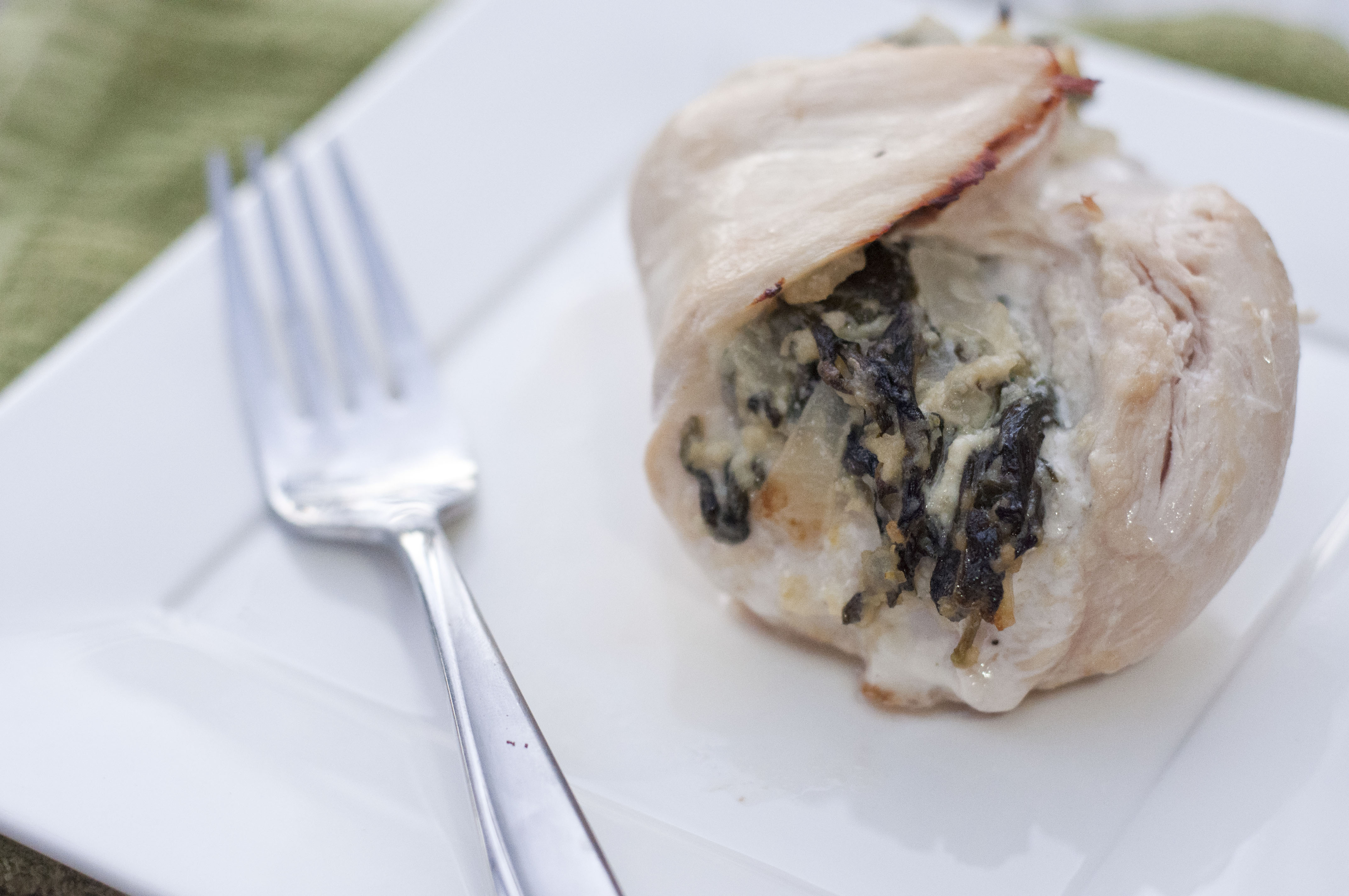 This photo depicts a delicious Spinach and Feta Stuffed Chicken Breast.