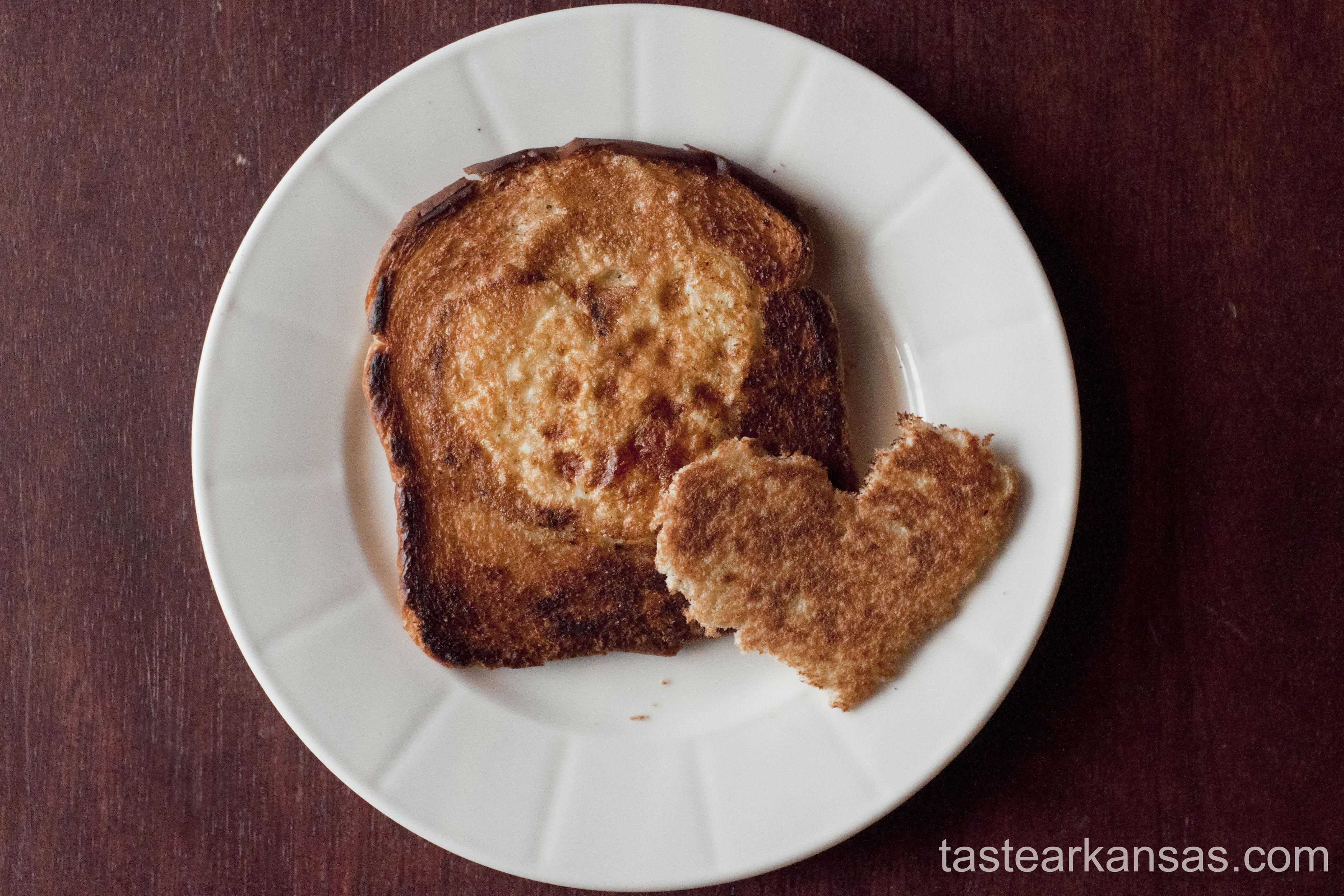 this photo is of a traditional egg in a hole with a valentine's day twist