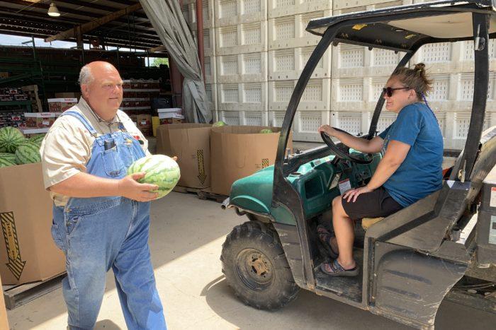 James Meeks carrying watermelon